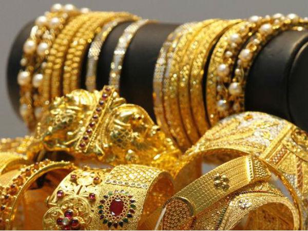 सोने की कीमतों में गिरावट, जबकि चांदी में उछाल