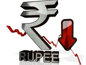 Rupee Trades Lower Against Dollar